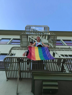 Hoyt Hall Rainbow Flag Unfurled on Fire Escape
