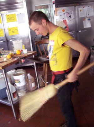 A Coop member cleaning their houses kitchen.